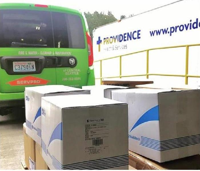 SERVPRO van with boxes of PPE being donated to local hospital
