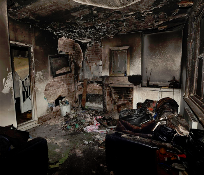 burned living room with furniture and items everywhere