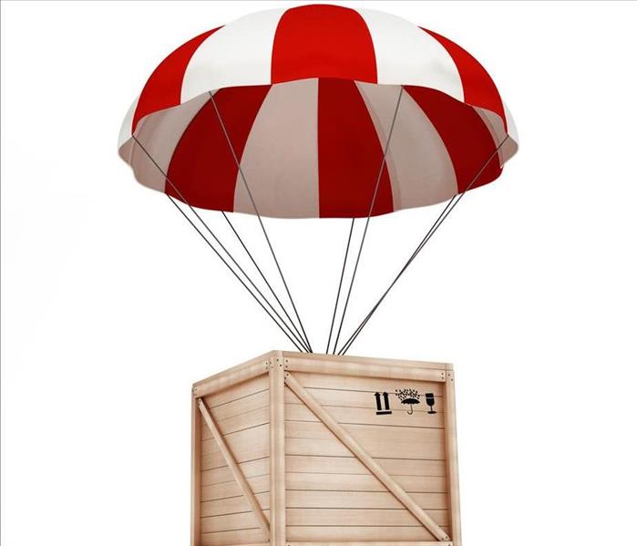 wooden box dropping with a parachute